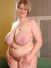 20 pound tits on blonde BBW swing as she fucks black cock!