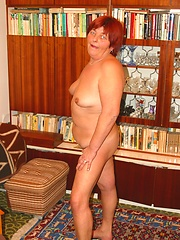 Redheaded mature woman shows off her pierced cunt