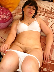 She takes off her pants to show her hairy hole
