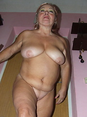 Naughty housewife getting naked and playfull