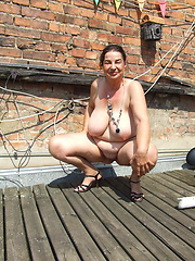 Kinky mature slut naked on a roof