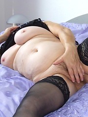 Fat granny likes her hairy aged pussy
