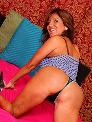 Anilos Tara Holiday flaunts her mature cougar frame in alluring lingerie