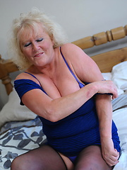Busty granny inserting pink dildo into own hole