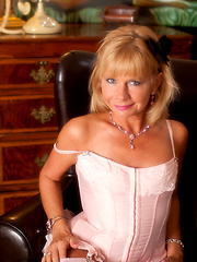 Blonde mature in stockings and sexy corset