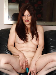 Smiley european mom playing with her favorite vibrator