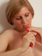 Older lady using red toy for her hungry holes
