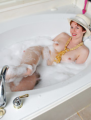Redhead amture relaxing in the bathroom