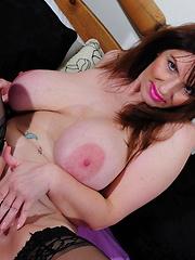 Huge breasted mature slut showing all