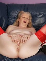 Naughty blonde mature slut masturbating on her couch