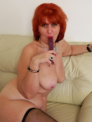 Horny red mature slut playing with her toy