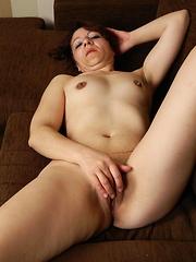 Horny mature slut masturbating on the couch