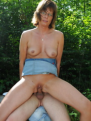 This horny housewife loves fucking two guys in the woods