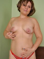 Busty mom showing her lovely curves