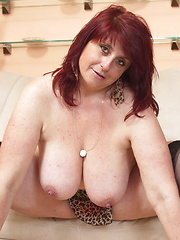 Chubby big breasted mature lady getting wet