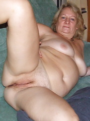 Mature slut cutting up her clothes and getting naked