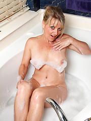 Peek in on the hot mom next door getting naughty in her bath