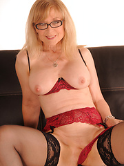Nina Hartley horny in red and black lingerie