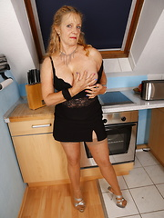 Horny German housewife gets dirty in her kitchen